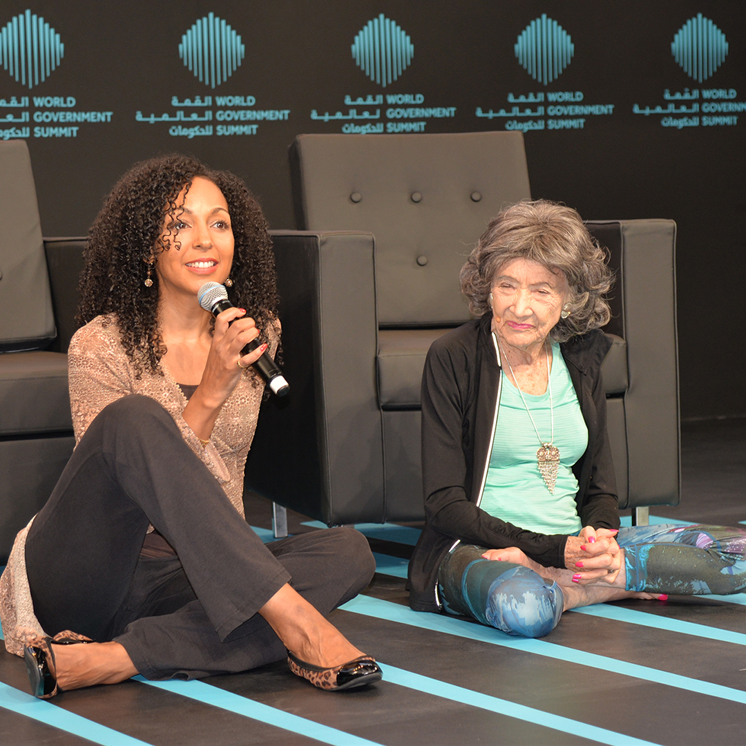 Teresa Kay-Aba Kennedy moderating conversation with 98-year-old yoga master Tao Porchon-Lynch at the World Government Summit in Dubai - February 14, 2017