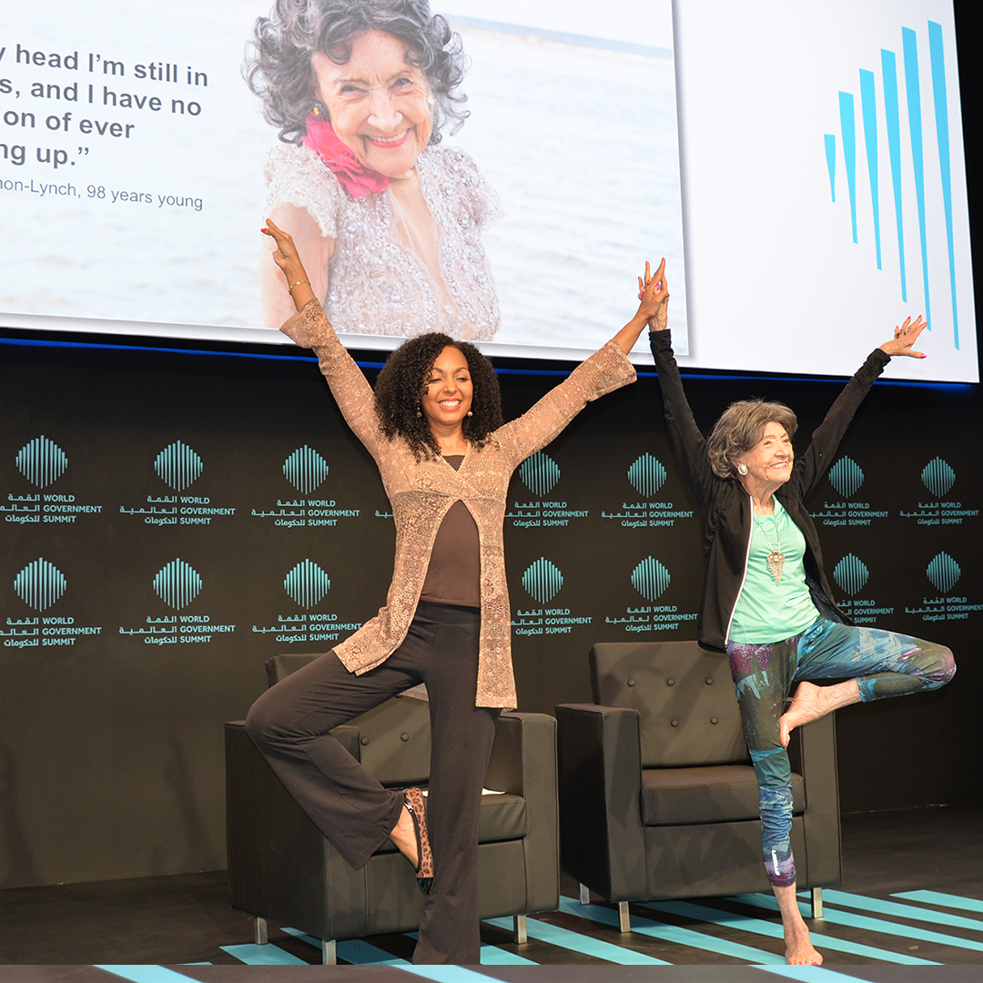 Teresa Kay-Aba Kennedy demonstrating yoga with 98-year-old yoga master Tao Porchon-Lynch at the World Government Summit in Dubai - February 14, 2017