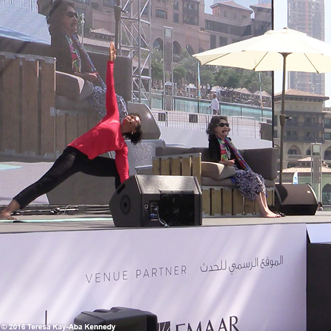 Teresa Kay-Aba Kennedy demonstrating yoga with 97-year-old yoga master Tao Porchon-Lynch at XYoga Dubai Festival - February 2016