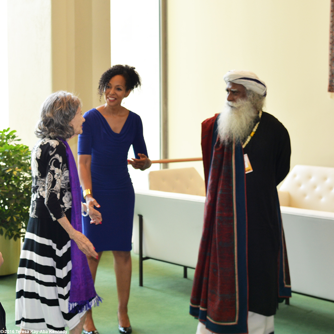 97-year-old yoga master Tao Porchon-Lynch, Teresa Kay-Aba Kennedy and Sadhguru Jaggi Vasudev and Teresa Kay-Aba Kennedy at United Nations International Yoga Day event – June 20, 2016