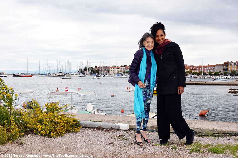 97-year-old yoga master Tao Porchon-Lynch and Teresa Kay-Aba Kennedy in Slovenia, October 8, 2015
