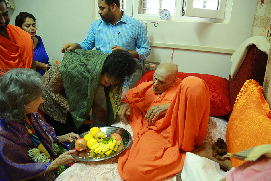 Teresa Kay-Aba Kennedy with Shwaasa Guru and 98-year-old yoga master Tao Porchon-Lynch receiving a blessing from 110-year-old Shivakumara Swami in Karnataka, India - June 23, 2017