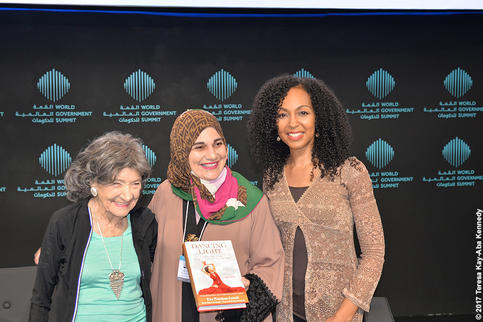 98-year-old yoga master Tao Porchon-Lynch and Teresa Kay-Aba Kennedy and Alaa Ershead at the World Government Summit in Dubai – February 14, 2017