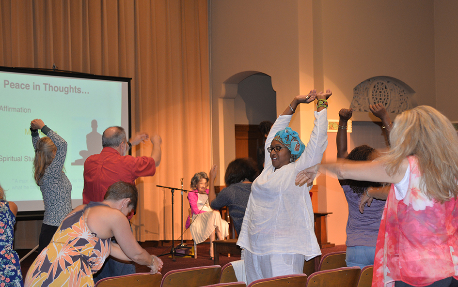 Participants in interactive exercise during The Gandhi Effect workshop with 97-year-old yoga master Tao Porchon-Lynch and empowerment expert Teresa Kay-Aba Kennedy in Kansas City - August 29, 2015