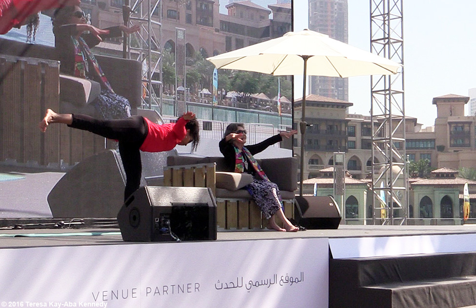 97-year-old Yoga Master Tao Porchon-Lynch teaching with Teresa Kay-Aba Kennedy at XYoga Dubai Festival – February 20, 2016
