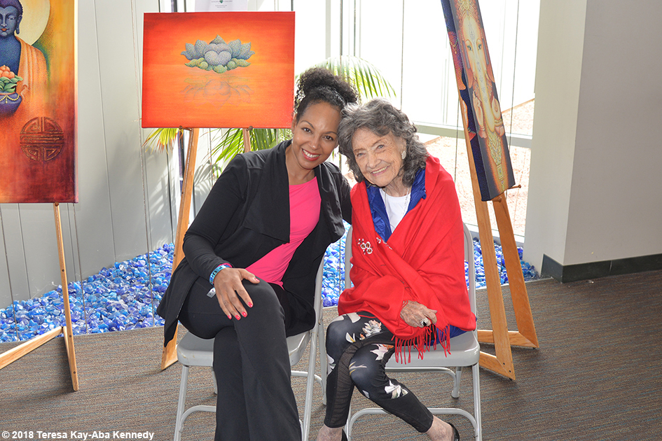 Teresa Kay-Aba Kennedy with 99-year-old yoga master Tao Porchon-Lynch at the Sedona Yoga Festival – February 10, 2018