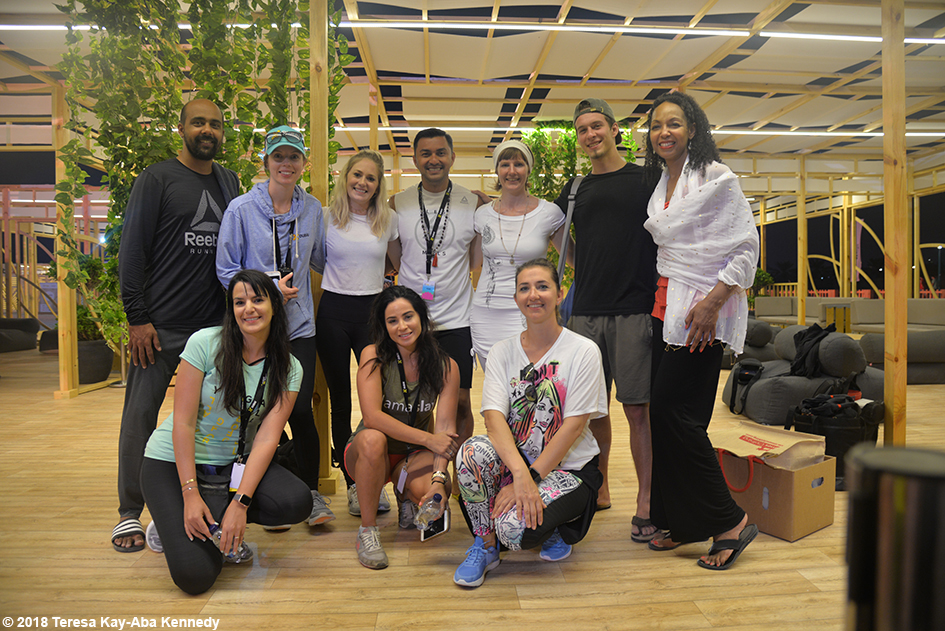 Teresa Kay-Aba Kennedy with fellow yoga teachers -- Ajith Shankara, Dovile Slavinskaite, Sara Fakhouri, Candace Cabrera Moore, Anjasmara, Sjha'ra Taylor, Daniel Morgan and Teresa Kay-Aba Kennedy -- at XYoga Dubai Festival on Kite Beach - March 17, 2018