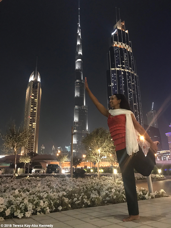 Teresa Kay-Aba Kennedy doing a partner pose with Burj Khalifa--the tallest building in the world - March 17, 2018