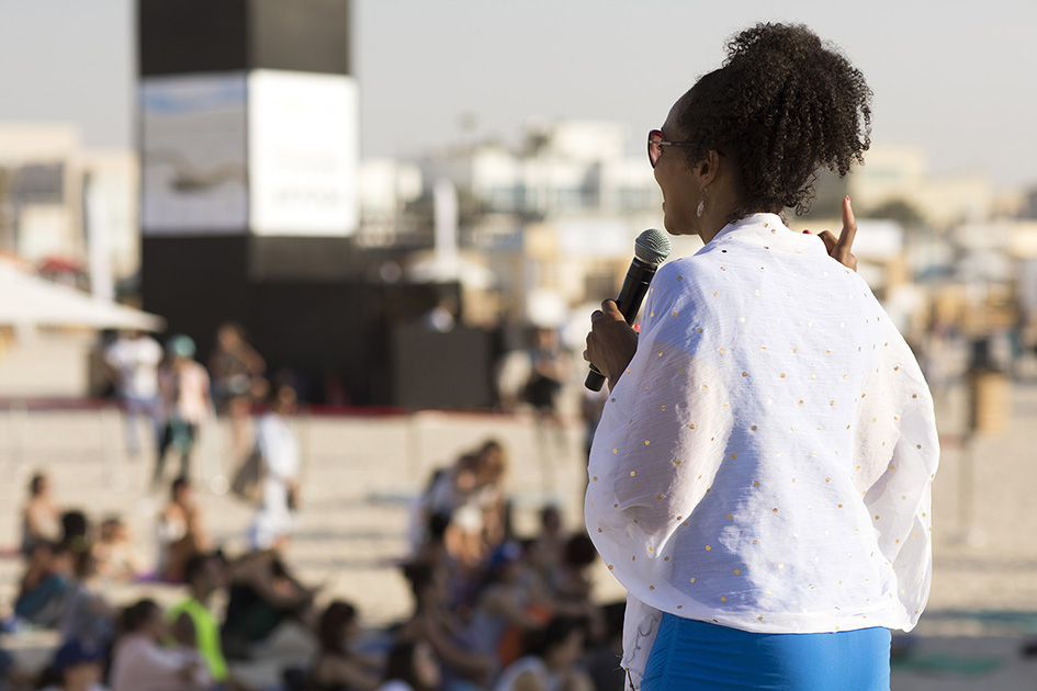 Teresa Kay-Aba Kennedy speaking at the XYoga Dubai Festival on Kite Beach - March 16, 2018