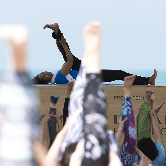 Teresa Kay-Aba Kennedy teaching Breathe & Burn Vinyasa Yoga session at XYoga Dubai Festival on Kite Beach - March 16, 2018