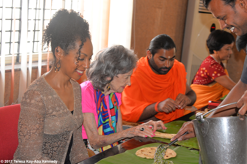 Teresa Kay-Aba Kennedy with Shwaasa Guru and 98-year-old yoga master Tao Porchon-Lynch eating at the Siddaganga Matha after meeting 110-year-old Shivakumara Swami in Karnataka, India - June 23, 2017
