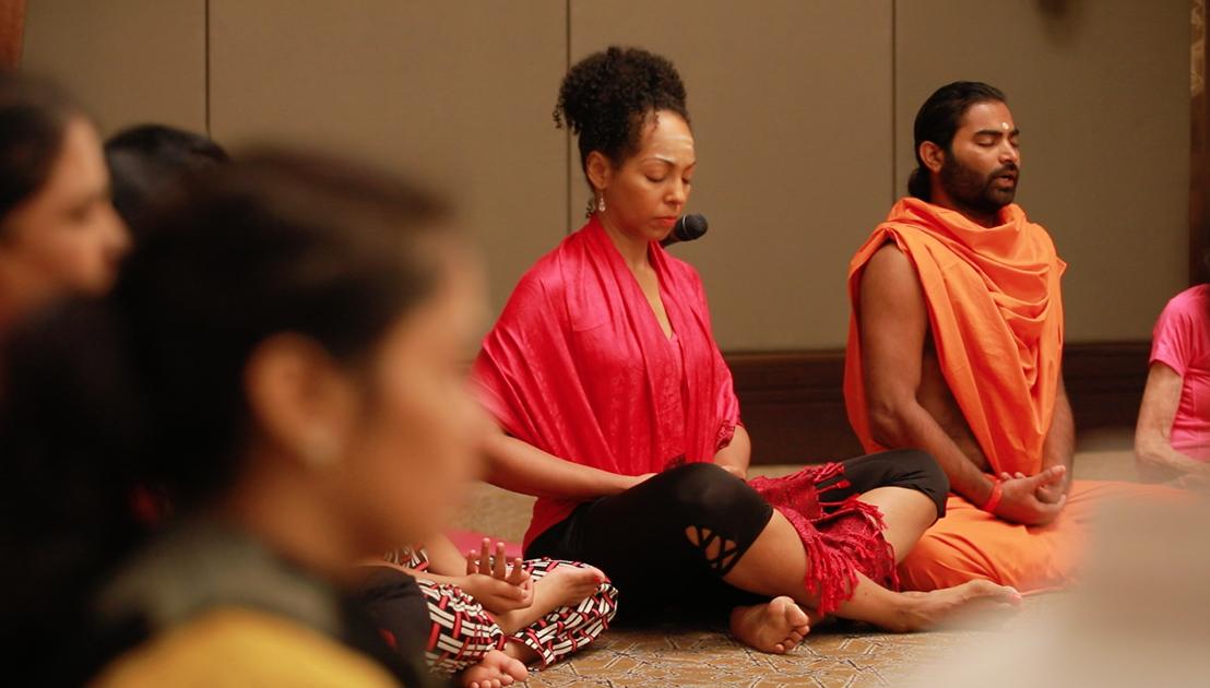 Teresa Kay-Aba Kennedy with Shwaasa Guru and 98-year-old yoga master Tao Porchon-Lynch doing Ishtalinga Meditation in Bangalore, India - June 24, 2017