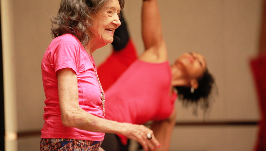 98-year-old yoga master Tao Porchon-Lynch teaching yoga with Teresa Kay-Aba Kennedy demonstrating in Bangalore, India - June 24, 2017