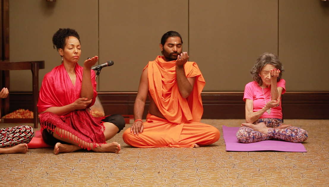 Teresa Kay-Aba Kennedy with Shwaasa Guru and 98-year-old yoga master Tao Porchon-Lynch doing Ishtalinga Meditation in Bangalore, India - June 24, 2017