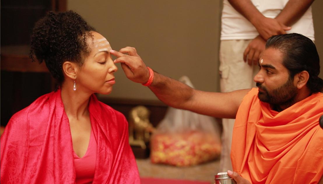 Teresa Kay-Aba Kennedy receiving Tripundra spiritual markings and bindu from Shwaasa Guru before Ishtalinga Meditation in Bangalore, India - June 24, 2017