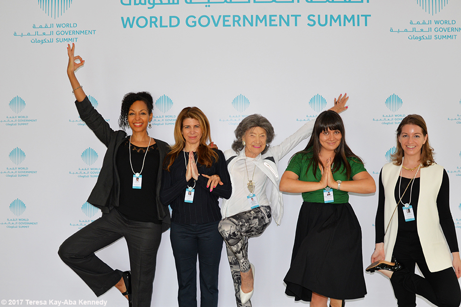 98-year-old yoga master Tao Porchon-Lynch with Teresa Kay-Aba Kennedy and Young Global Leaders at the World Government Summit in Dubai - February 2017