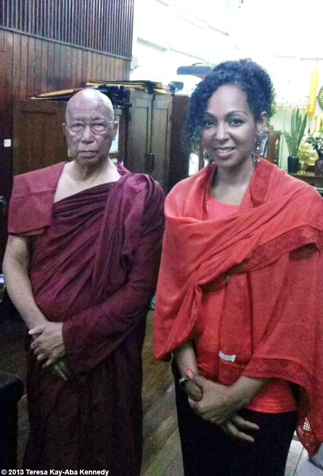 Teresa Kay-Aba Kennedy with a spiritual leader in Myanmar as part of the Young Global Leader Summit in conjunction with the World Economic Forum on East Asia - June 2013