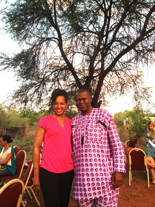 Young Global Leaders Teresa Kay-Aba Kennedy and Akinwale Ojomo under the Tree where the Royal Bafokeng Nation Community Leaders Meet in South Africa - November 2013