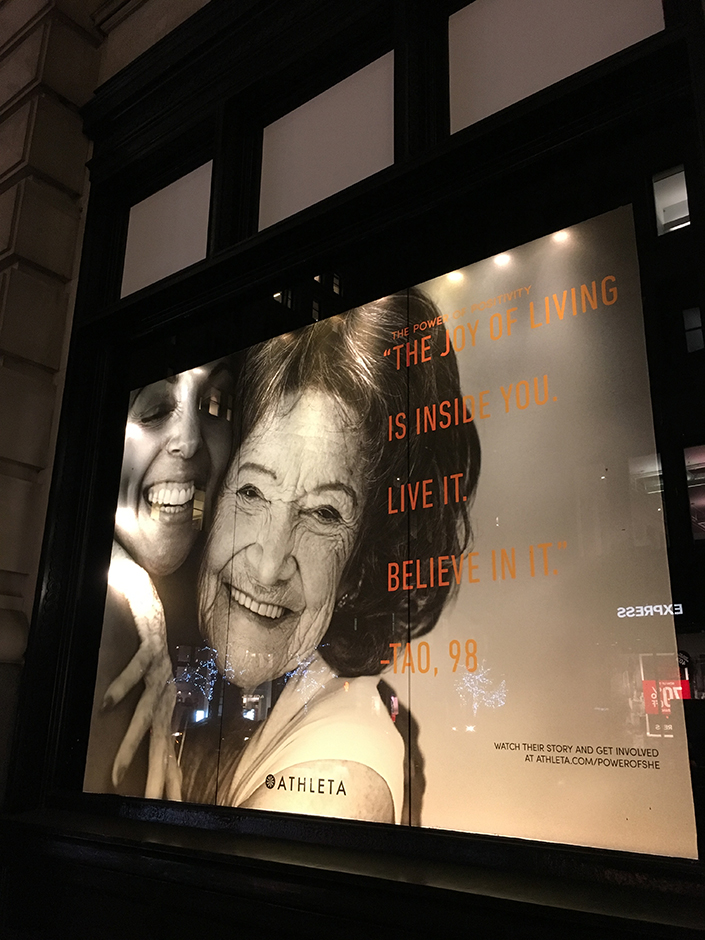 98-year-old yoga master Tao Porchon-Lynch and Teresa Kay-Aba Kennedy featured in window of Athleta store on 18th & 5th in New York City