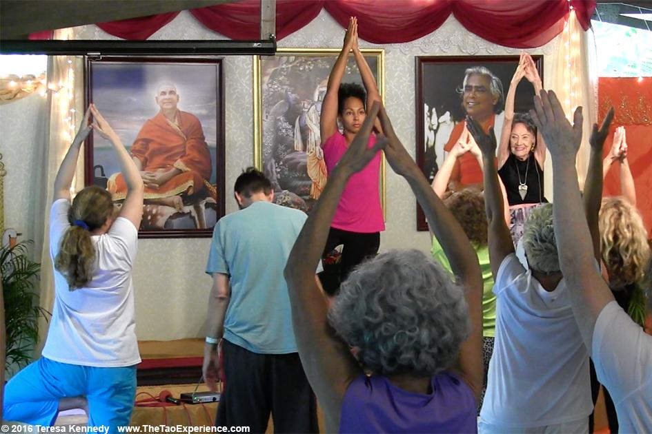 97-year-old Yoga Master Tao Porchon-Lynch teaching and Teresa Kay-Aba Kennedy assisting at Sivananda Ashram Yoga Retreat Bahamas – January 11, 2016