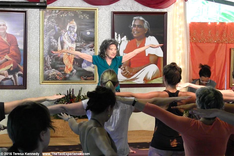 97-year-old Yoga Master Tao Porchon-Lynch teaching and Teresa Kay-Aba Kennedy assisting at Sivananda Ashram Yoga Retreat Bahamas – January 9, 2016