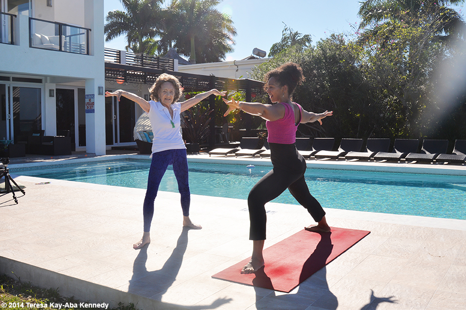 96-year-old yoga master Tao Porchon-Lynch giving Teresa Kay-Aba Kennedy a private yoga lesson in Montego Bay, Jamaica - December 2014