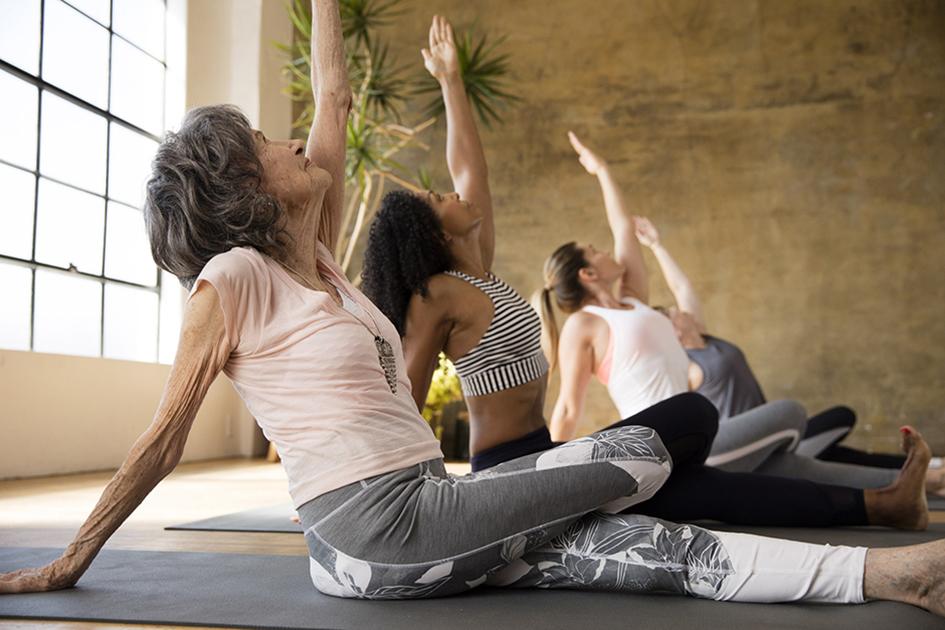 Teresa Kay-Aba Kennedy and 98-year-old yoga master Tao Porchon-Lynch in Athleta