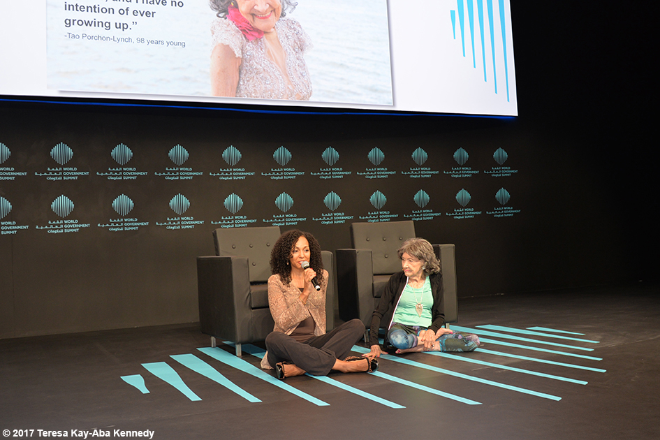 Teresa Kay-Aba Kennedy and 98-year-old yoga master Tao Porchon-Lynch presenting at the World Government Summit in Dubai – February 14, 2017