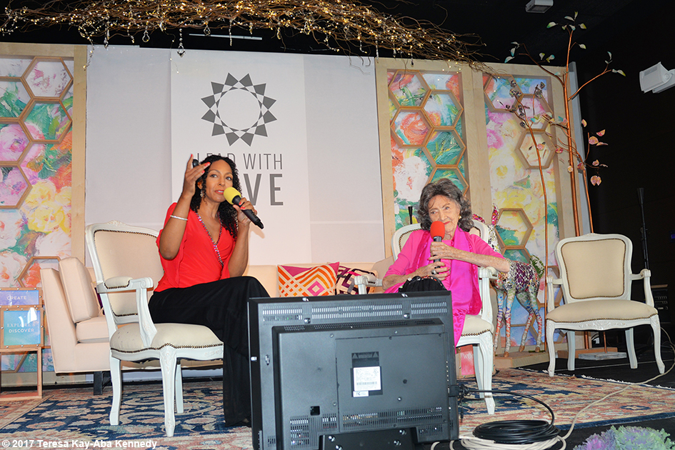 Teresa Kay-Aba Kennedy moderating Conversation with a Master with 99-year-old Tao Porchon-Lynch at the Lead With Love Conference in Aspen, Colorado - October 26, 2017