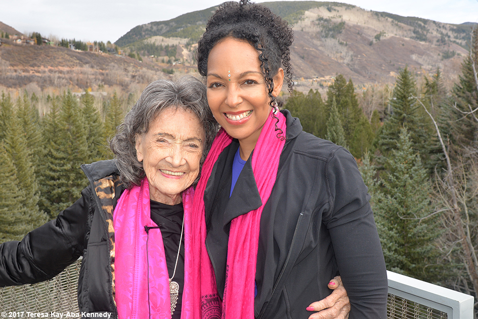 99-year-old yoga master Tao Porchon-Lynch and Teresa Kay-Aba Kennedy at Lead With Love Conference in Aspen, Colorado - October 27, 2017