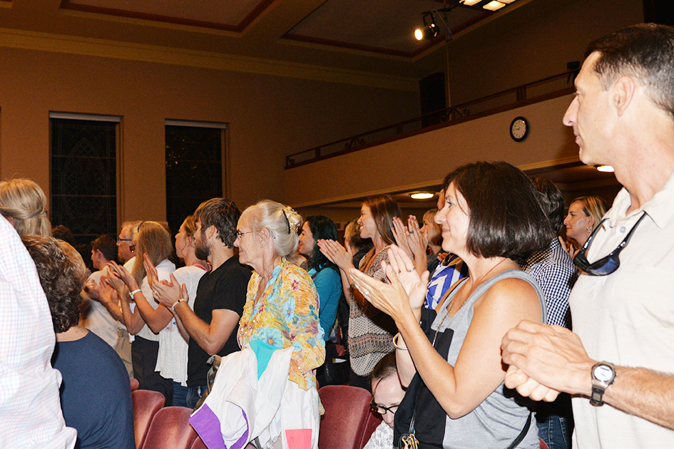 Audience enjoying 97-year-old yoga master Tao Porchon-Lynch and empowerment expert Teresa Kay-Aba Kennedy in Kansas City - August 28, 2015