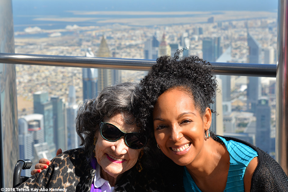 97-year-old Yoga Master Tao Porchon-Lynch and Teresa Kay-Aba Kennedy on top of Burj Khalifa in Dubai – February 18, 2016