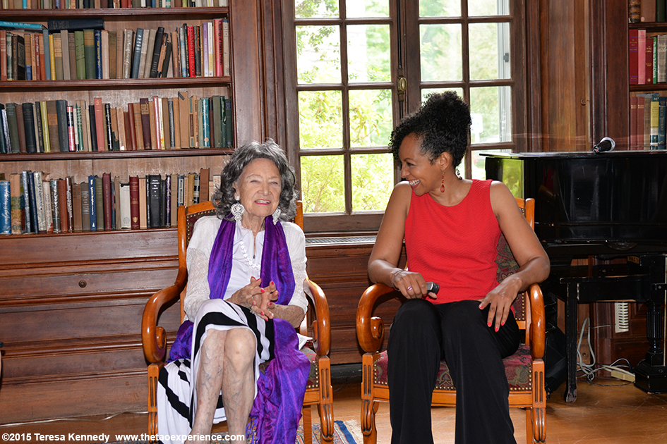 96-year-old yoga master Tao Porchon-Lynch and Teresa Kay-Aba Kennedy meditating as part of Conversation with a Master event at Wainwright House in Rye, NY–June 16, 2015