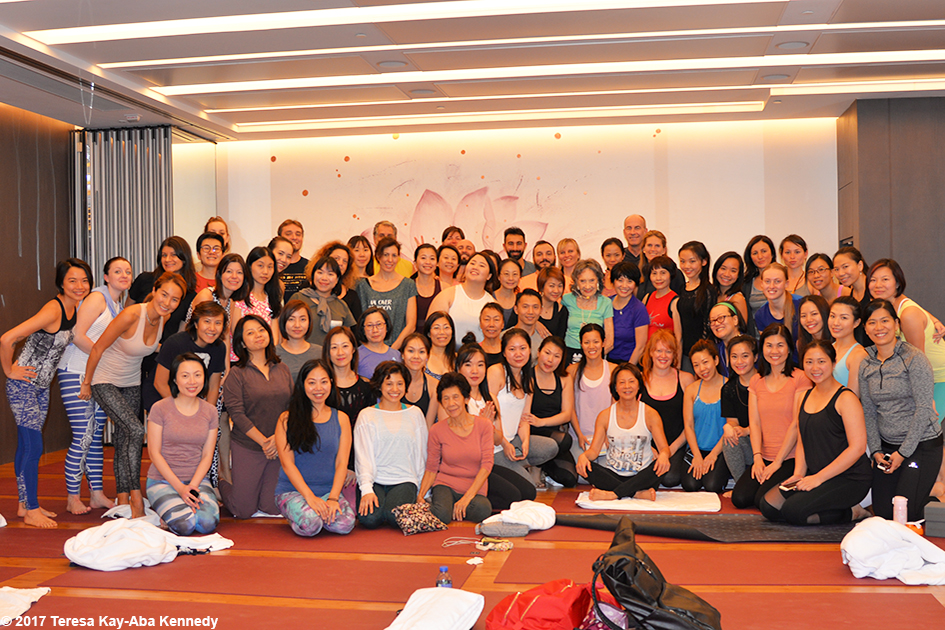 Class photo of yoga session with 98-year-old yoga master Tao Porchon-Lynch at Pure Yoga in Hong Kong - December 18, 2017