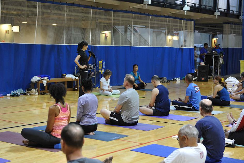 Teresa Kay-Aba Kennedy doing yoga at the Pentagon with 93-year-old yoga master Tao Porchon-Lynch - June 8, 2012