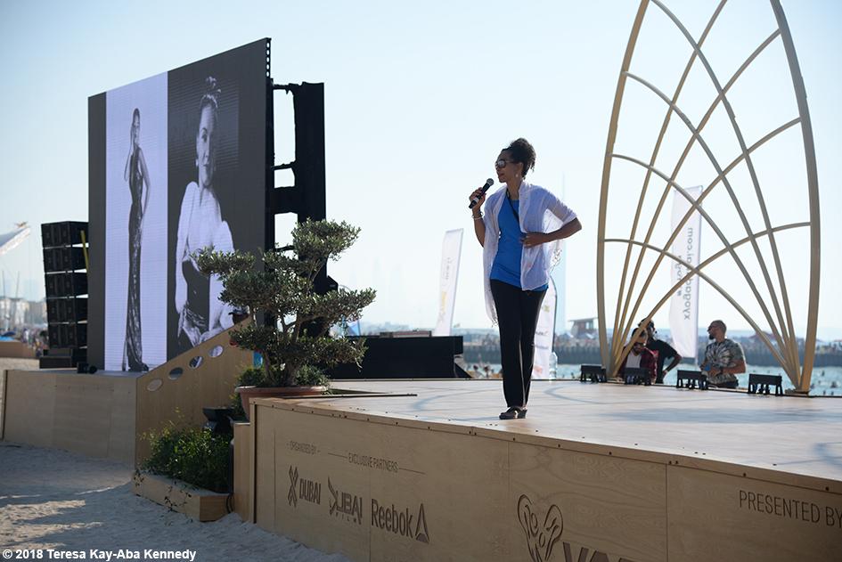 Teresa Kay-Aba Kennedy speaking at the XYoga Dubai Festival on Kite Beach - March 16, 2018