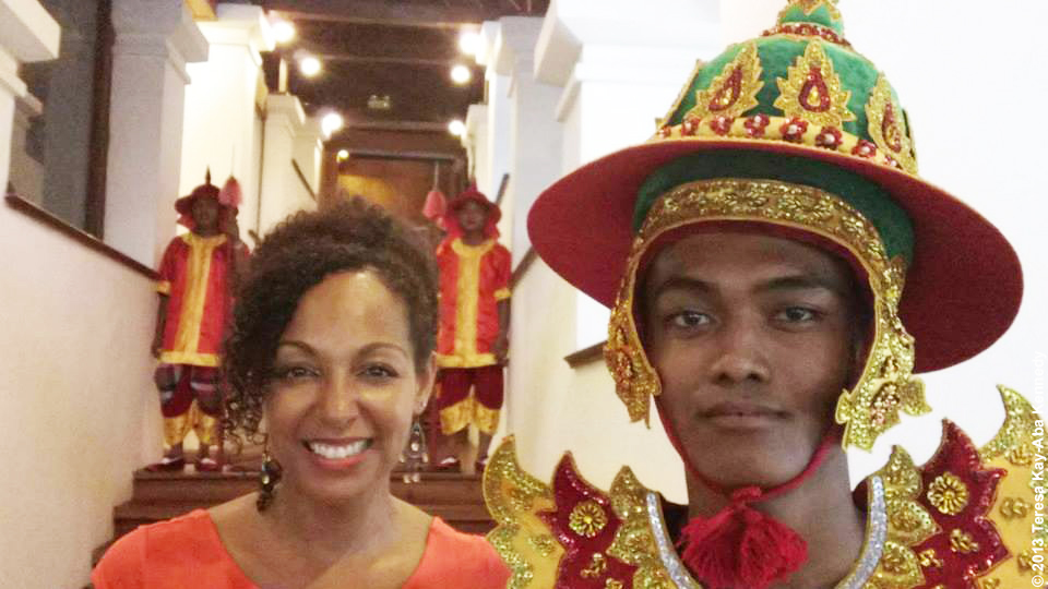 Teresa Kay-Aba Kennedy with a local guard in Yangon during Young Global Leader Summit and World Economic Forum in Myanmar - June 2013